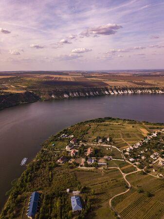 Arial view over the river and small village in autumn. Moldova republic of. Molovata village.
