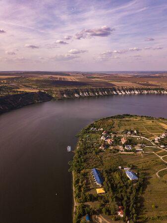 Arial view over the river and small village in autumn. Moldova republic of. Molovata village. River Dniester.