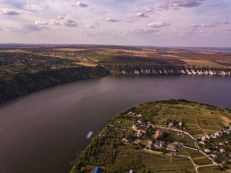 Arial view over the river and small village in autumn. Moldova republic of. Molovata village. River Dniester.