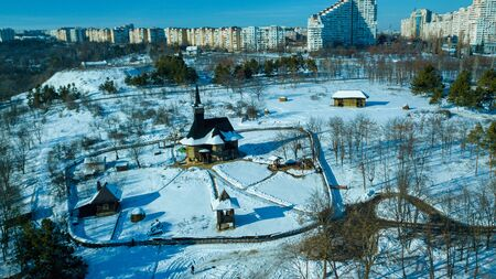 top view of a old wooden church in Kishinev, republic of Moldova. Winter landscape whit wooden church