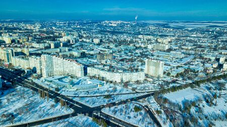 Top view of city in winter at sunset on sky background. Aerial drone photography concept. Kishinev, Republic of Moldova. Foto de archivo