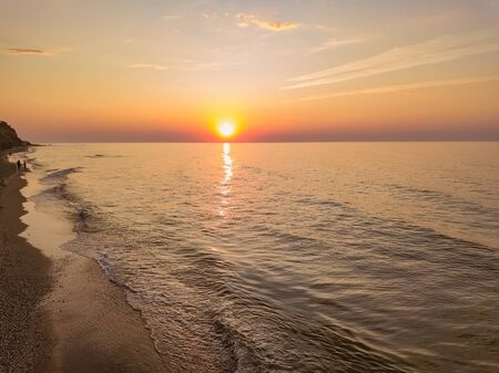 Aerial panoramic view of sunrise over ssea. Nothing but sky, clouds and water. Beautiful serene scene