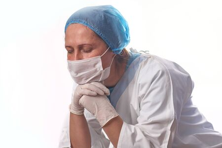 Portrait of a female doctor surgeon feeling down, exhausted, frustrated, very tired, .. on white background Standard-Bild - 150454356