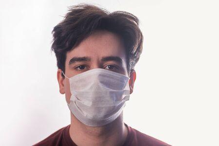 Man in a medical mask close up portrait. Healthcare. Covid-19 coronavirus symptoms Standard-Bild