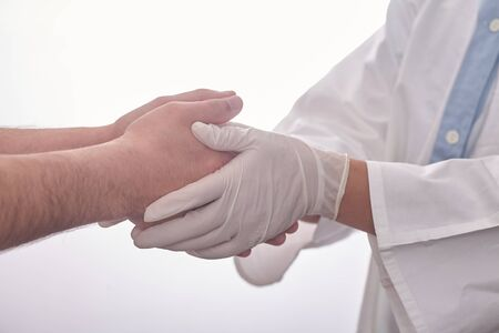 Female doctor holding patients hand. Providing compassion during difficult times.