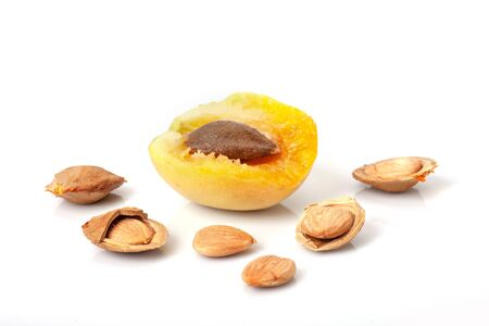 Half of and kernels apricot isolated on white background