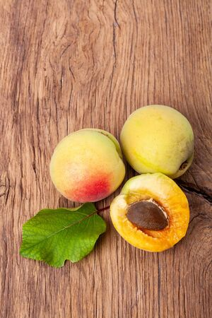 apricots on a dark wooden background. toning. selective focus