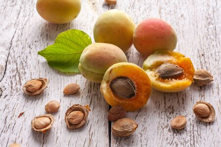 Apricot fruit. Fresh organic apricots on a white wooden background. Vega food.