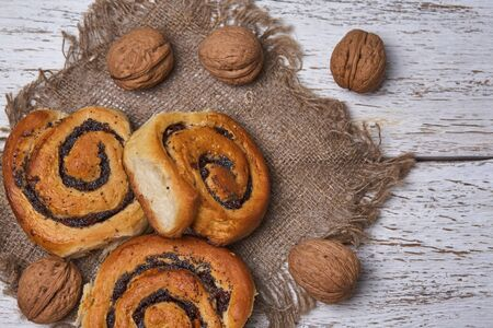 Tasty buns with raisins on a white rustic wooden table. fresh bakery. breakfast. bread. top view