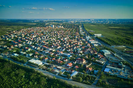 Aerial view from drone. Aerial view amazing sunset over of the suburbs with the city, far villages and fields Standard-Bild - 151120725