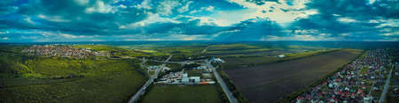 Aerial view from drone. Aerial view amazing sunset over of the suburbs with the city, far villages and fields Standard-Bild - 151120731
