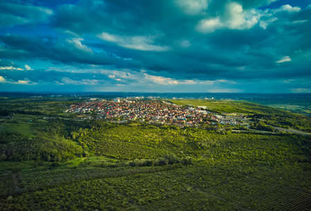 Aerial view from drone. Aerial view amazing sunset over of the suburbs with the city, far villages and fields Standard-Bild - 151120732
