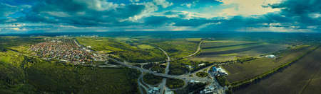 Aerial high drone flight over evening road traffic. Highway and overpass with cars and trucks, interchange, two-level road junctio. Freeway, line. Standard-Bild - 151120733