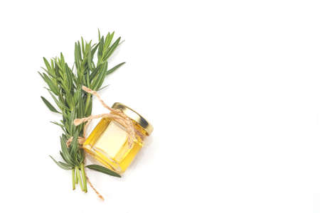 Bottle with essential oil and rosemary isolated on white background. Standard-Bild