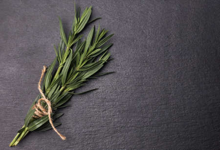 Rosemary herb on stone table. Top view with copy space Standard-Bild