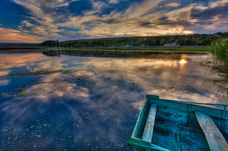 Magical Sunset Over the Riveer. Colorful sky under sunlit reflected in water. Wonderful Natural Background, view with Dramatic sky