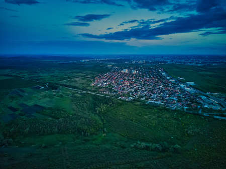 Aerial view from drone. Aerial view amazing sunset over of the suburbs with the city, far villages and fields