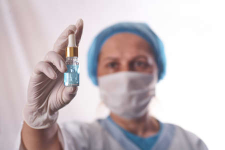 Doctor holds in his hands the drip with the drug. Standard-Bild