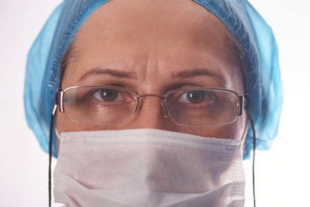 Close up head shot of young female scientist in glasses and mask. Standard-Bild