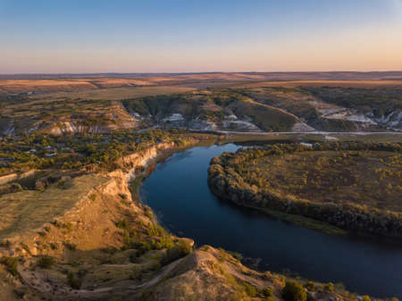 Magestic sunset over river. Autumn landscape. Dniester river, Moldova. Standard-Bild