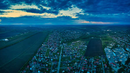 Aerial view from drone. Aerial view amazing sunset over of the suburbs with the city, far villages and fields Stock fotó