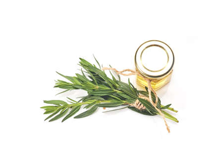 Bottle with essential oil and rosemary isolated on white background. Stock fotó