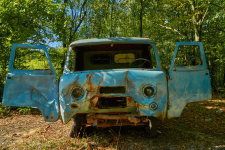 Abandoned old deterioration car in the autumn forest