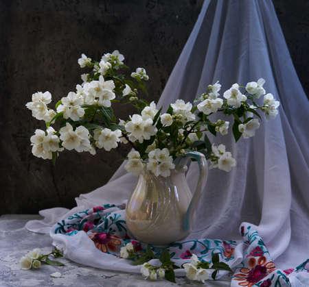 Jasmine flowers in a white vase. Stillife with spring flowers. 写真素材