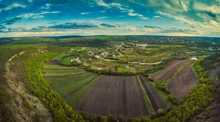 Little moldavian village Goeni in green lands, aerial view, summer time, Moldova republic of.