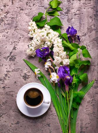 Coffee and lilac flowers on gray concrete background Zdjęcie Seryjne