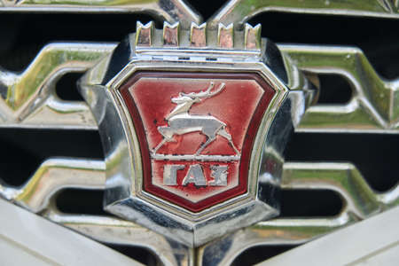 Kishinev, Moldova, November 5, 2020: Close up The radiator grille and emblem of the Russian car Chaika made in USSR Seagull . Old cars
