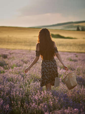 Woman with a basket in a lavender field