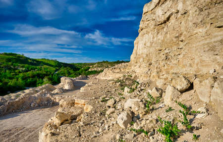 Landscape of stone quarry on a summer day.
