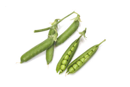 Pods of green peas with leaves isolated on white background Standard-Bild