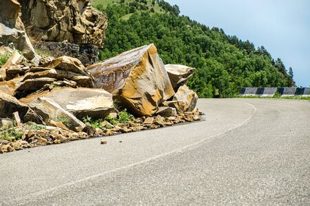 Rockfall on the road in the mountains.
