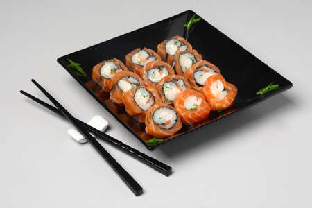 Japanese Food Sushi Set in Black Plate on the Table