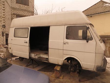 White microbus repair Stock Photo