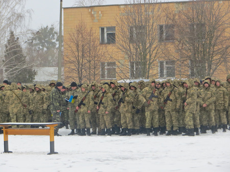 new recruits: POLTAVA, UKRAINE - MARCH 29, 2015: Ukrainian soldiers swear a military oath of loyalty to Ukraine at 29 march 2015 in Poltava, Ukraine