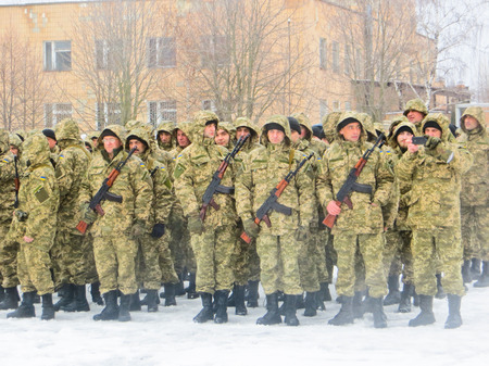 conscription: POLTAVA, UKRAINE - MARCH 29, 2015: Ukrainian soldiers swear a military oath of loyalty to Ukraine at 29 march 2015 in Poltava, Ukraine