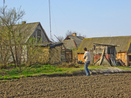 ploughed: Farmer on a ploughed field Stock Photo