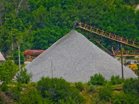 conveyor with piles of gravel granite quarry