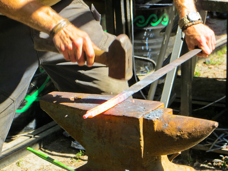 forging iron on anvil