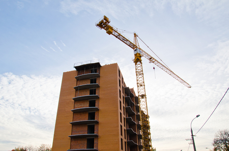 High building crane at a construction site Stock Photo