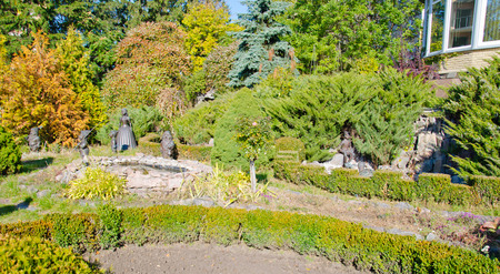 Characters of the fairy tale about Snowwhite in a park