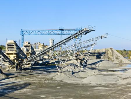 Conveyor and mining equipment in the granite quarry Stock Photo