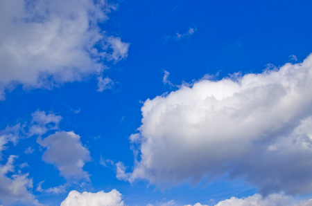 White clouds in the deep blue sky