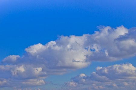 nebulosity: White clouds in the deep blue sky