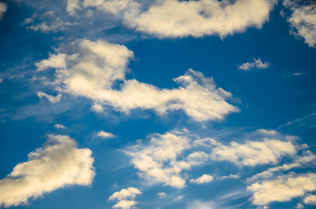 White clouds in a deep blue sky Stock Photo