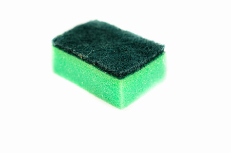 Kitchen sponge isolated on a white background