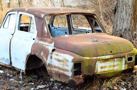 rusty car: Old rusty car body on a ground Editorial
